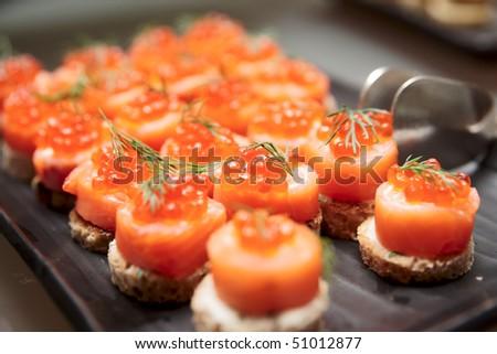 Salmon canapes, close up shot, narrow focus