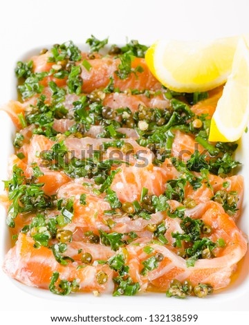 Salmon carpaccio - fresh salmon slices in marinade