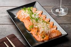 Salmon carpaccio with daikon