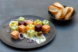 Salmon Cubes Plate with Beetroot Cubes, Cucumber Cubes, Potatoes Cubes, Cream Cheese, chives, Red onion and capers, Served With Soft Pretzel Stick