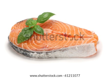Salmon cutlet with basil, isolated on white