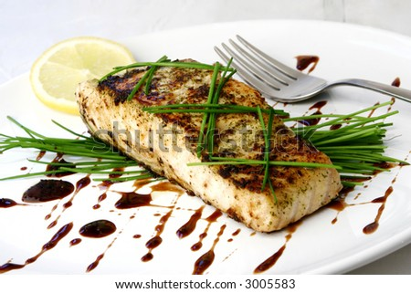 Salmon dish with chive - stock photo