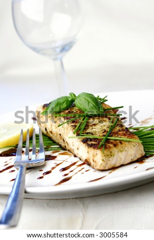 Salmon dish with chive and basil