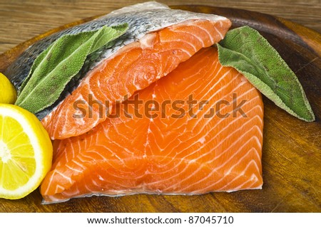 salmon fillet close up on wood table