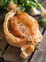 Salmon fillet in baked paper, selective focus