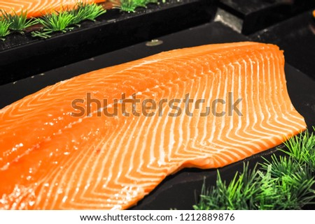 Salmon fillet portions selling in supermarket