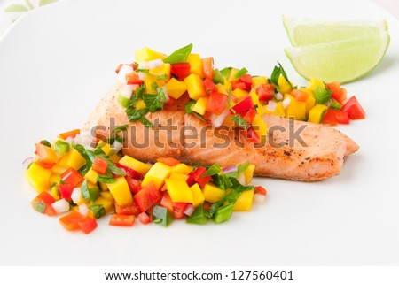 Salmon fillet with mango salsa, healthy eating. selective focus