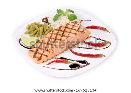 Salmon Fillet with Risotto. Isolated on a white background.