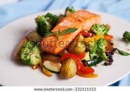salmon fillet with vegetables and basil on a plate