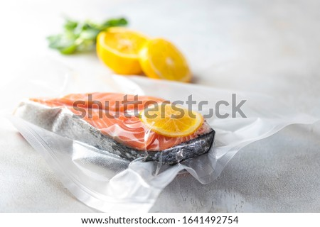 Salmon fillets in a vacuum package. Sous-vide, new technology cuisine. Selective focus, copy space Photo stock ©