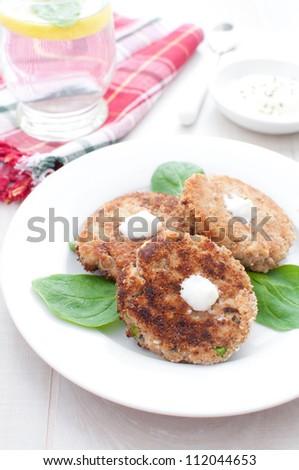 Salmon fishcake patties with white sauce