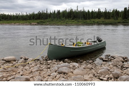 salmon fishing river boat parked on the shore