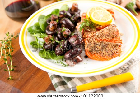 Salmon Grilled with Mustard and Served with Crimini Mushrooms Sauteed in Red Wine