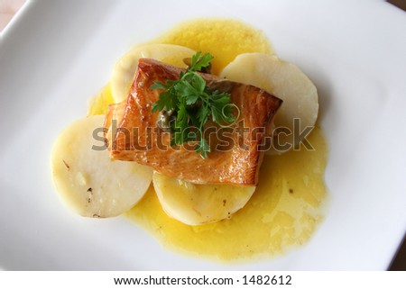 Salmon in olive oil and freshly baked new potatoes