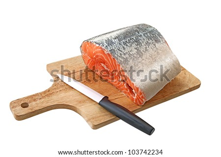 Salmon on a cutting board isolated over white background