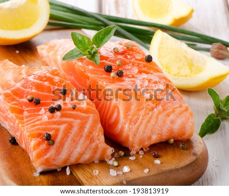 Salmon on a wooden board Selective focus