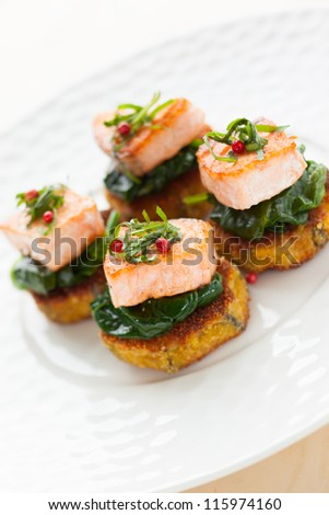 salmon on the eggplant and spinach