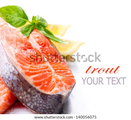 Salmon. Raw Salmon Red Fish Steak with Salt, Herbs and Lemon isolated on a White Background. Trout