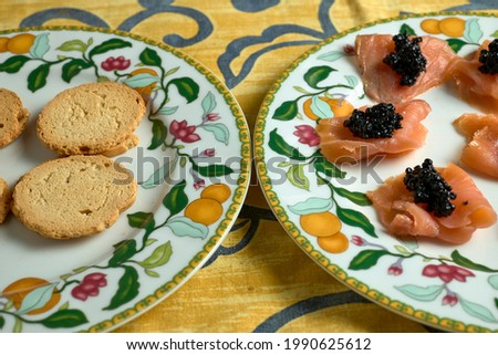 Salmon rolls with fish roe and toast for canapés Photo stock ©