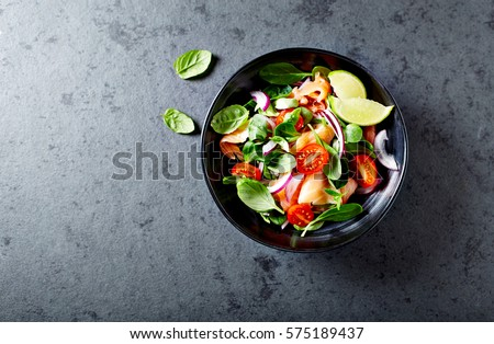 Salmon salad with baby spinach and corn salad #575189437