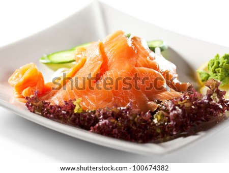 Salmon Sashimi - Sliced Raw Salmon on Daikon (White Radish) with Seaweed and Cucumber