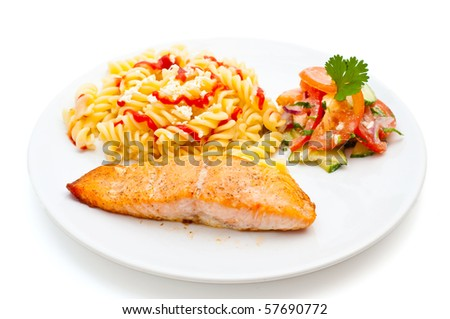 salmon served with pasta and salad