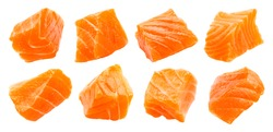 Salmon slices isolated on white background with clipping path, cubes of red fish, ingredient for sushi or salad, macro
