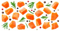 Salmon slices isolated on white background with clipping path, cubes of red fish with rosemary and peppercorns, ingredient for sushi or salad, macro