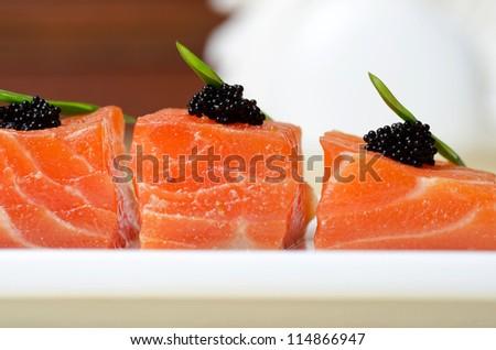 Salmon Slices with black tobiko caviar