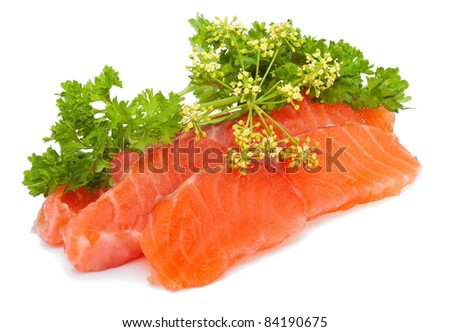 Salmon slices with parsley on white background