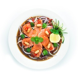 Salmon Spicy Salad in Pickled fish sauce Thai spicy Food decorate with cucumber and lime Asian Food Appetizer dish break time goodtasty diet top view