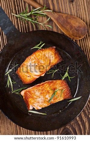salmon steak fried in the iron pan - stock photo