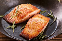 salmon steak in the frypan