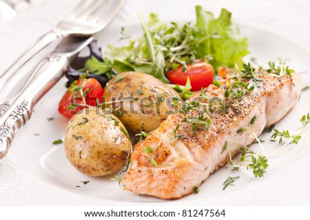 Salmon steak roasted with jacket potato