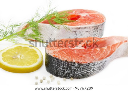 Salmon steak with lemon and dill on white bachground