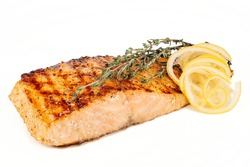 Salmon steak with lemon and rosemary on white background
