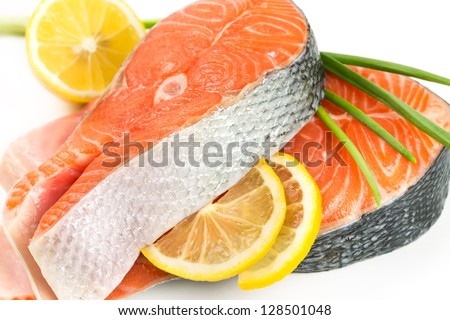 Salmon steak with lemon  on white background