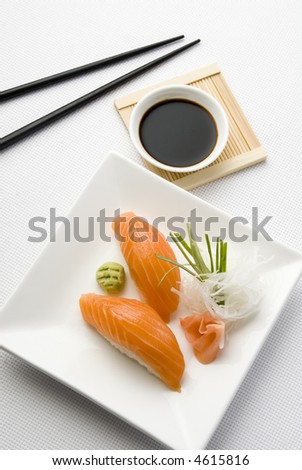 salmon sushi close up over white dish - stock photo