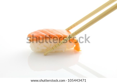 Salmon sushi with chopsticks