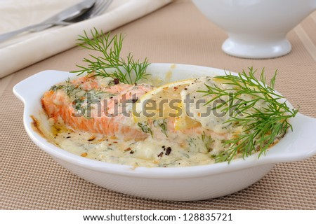 Salmon under gentle creamy lemon sauce with spices