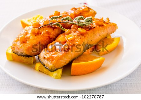 Salmon with orange and mint sauce - stock photo