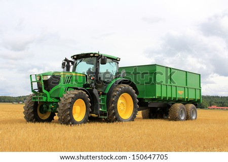 SALO, FINLAND - AUGUST 10: John Deere 6170R tractor and Palmse 1900 trailer on display at the annual Puontin Peltopaivat Agricultural Harvesting and Ploughing Show on August 10, 2013 in Salo, Finland.