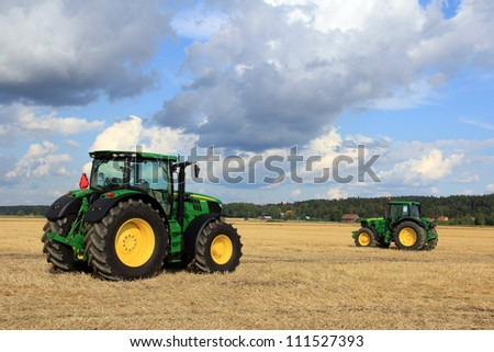 SALO, FINLAND - AUGUST 18: New John Deere tractors on display at the annual soil preparation and harvesting event Puontin peltopaivat at Puonti field in Salo, Finland August 18, 2012.