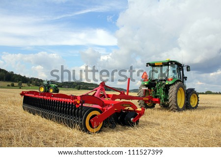 SALO, FINLAND - AUGUST 18:Vaderstad Carrier stubble cultivator and John Deere tractor at the annual soil preparation and harvesting event Puontin peltopaivat in Salo, Finland August 18, 2012.