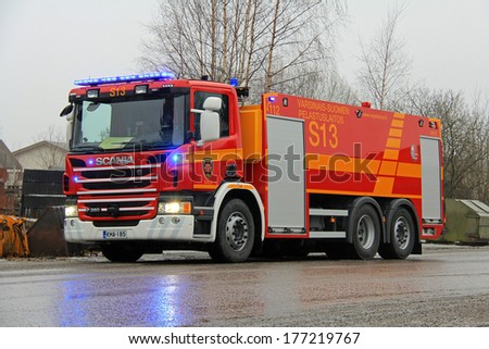 SALO, FINLAND - FEBRUARY 16, 2014: Scania P360 Fire engine with flashing lights at the fire scene of Salo Cement Plant. The plant was completely destroyed in the fire.