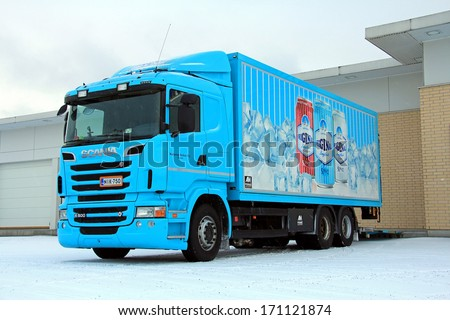 SALO, FINLAND - JANUARY 11, 2013: Scania R500 truck delivering beverages to a store. In Finland, a very common New Year\'s resolution is not to drink any alcohol in January.