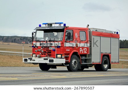 SALO, FINLAND - MARCH 22, 2015: Classic Scania Fire truck rushes along highway 25. Scania fire trucks have been used by Finnish fire departments for over 100 years.