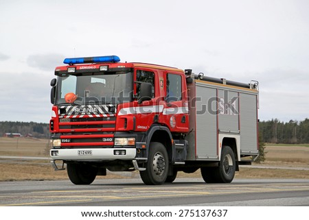 SALO, FINLAND - MARCH 22, 2015: Scania 114C 340 Fire truck moves along highway 52. Scania fire trucks have been used by Finnish fire departments for over 100 years.