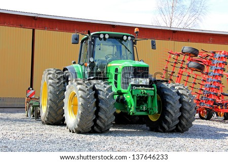 SALO, FINLAND - MAY 4: John Deere 6630 Tractor in Salo, Finland on May 4, 2013. For 7th straight year, Deere & Company earns position on Ethisphere Institute's World's Most Ethical Companies list.
