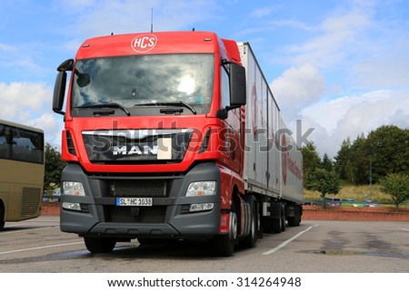 SALO, FINLAND - SEPTEMBER 5, 2015: Red MAN TGX 26.480 truck and full trailer parked in Salo. MAN Truck and Bus celebrates 100 years in 2015.